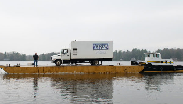 SoundSeals Insulation truck transported by tug boat